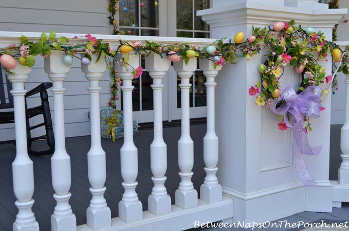 Porch Rail Decorated with Spring Egg Garland #easter #diy #porch #decor #decorhomeideas