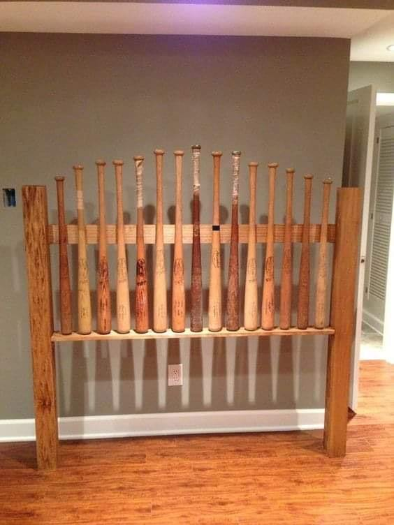 Repurposed Baseball Bats Headboard. Creative use of baseball bats to make a wooden headboard. You can glue or nail them for extra durability. #headboard #bedroom #homedecor #decorhomeideas
