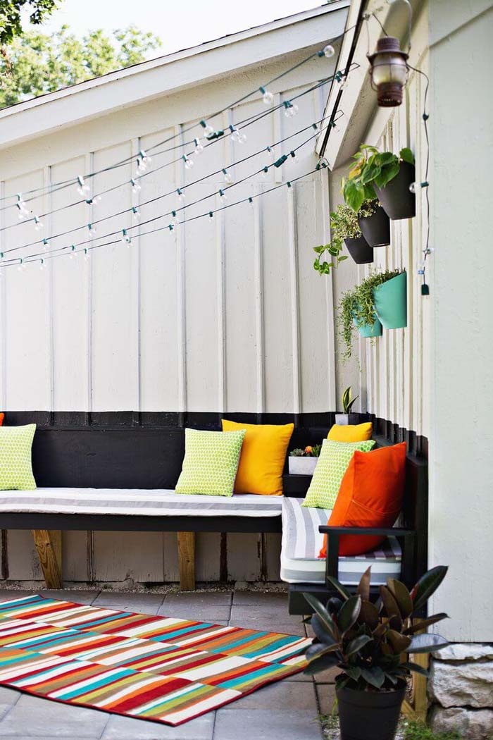 Wall of Pots and Curtain of Lights #diy #porch #patio #projects #colorful #decorhomeideas
