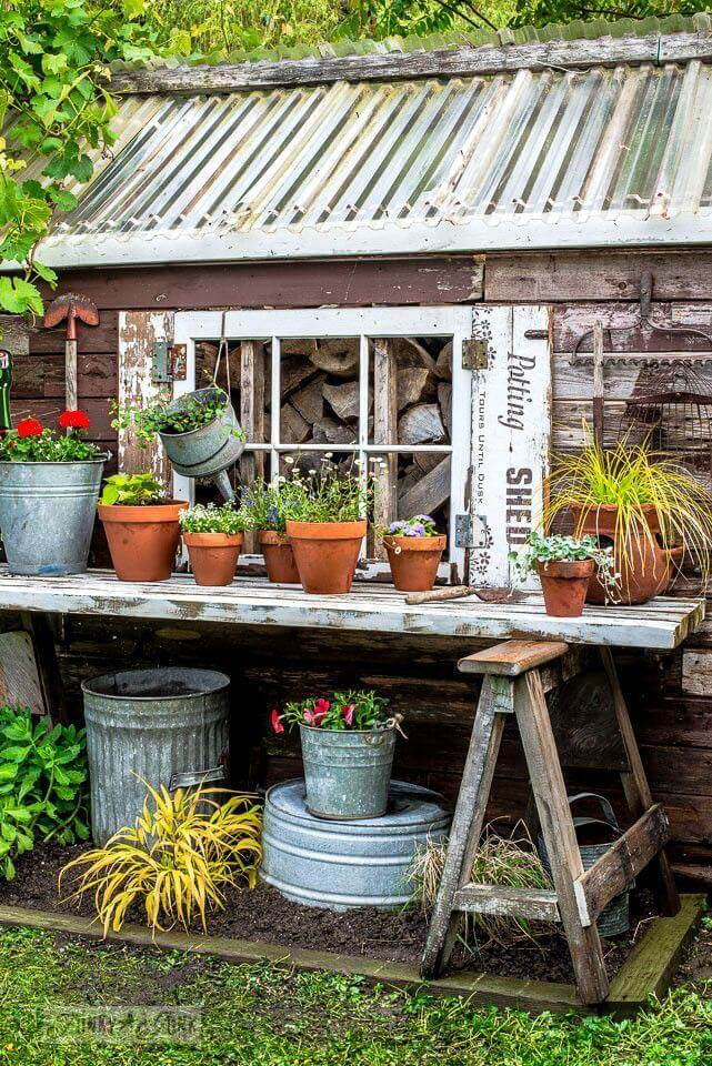 Easy Upcycled Door and Sawhorse Potting Table #diy #potting #bench #garden #decorhomeideas