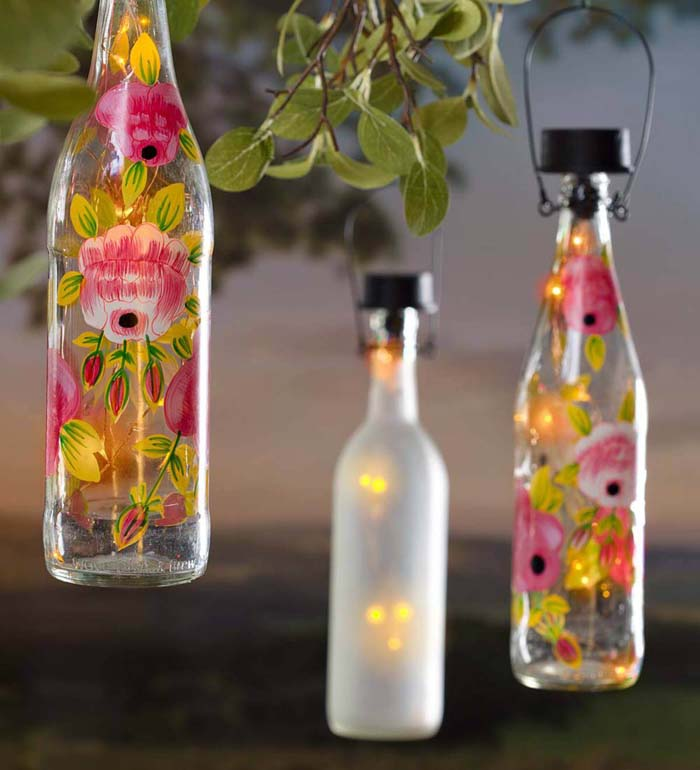 Hanging Solar Bottles Turned Lanterns #diy #solar #lights #solarlight #garden #decorhomeideas