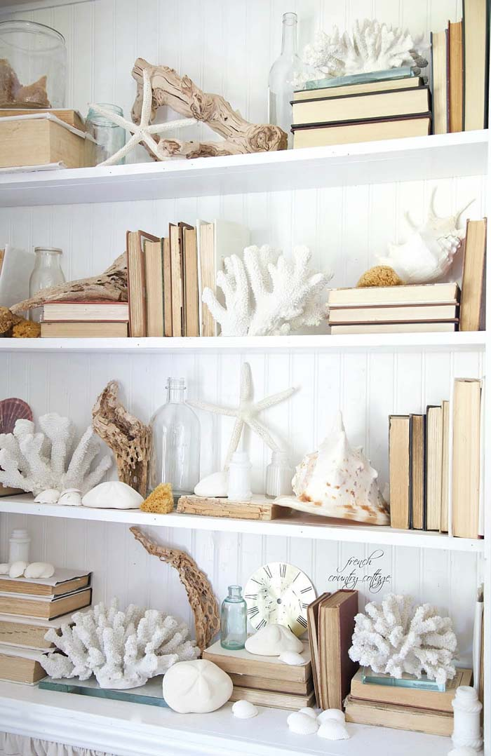 A Bookcase Crawling with Coral and Shells #beach #coastal #decoration #decorhomeideas