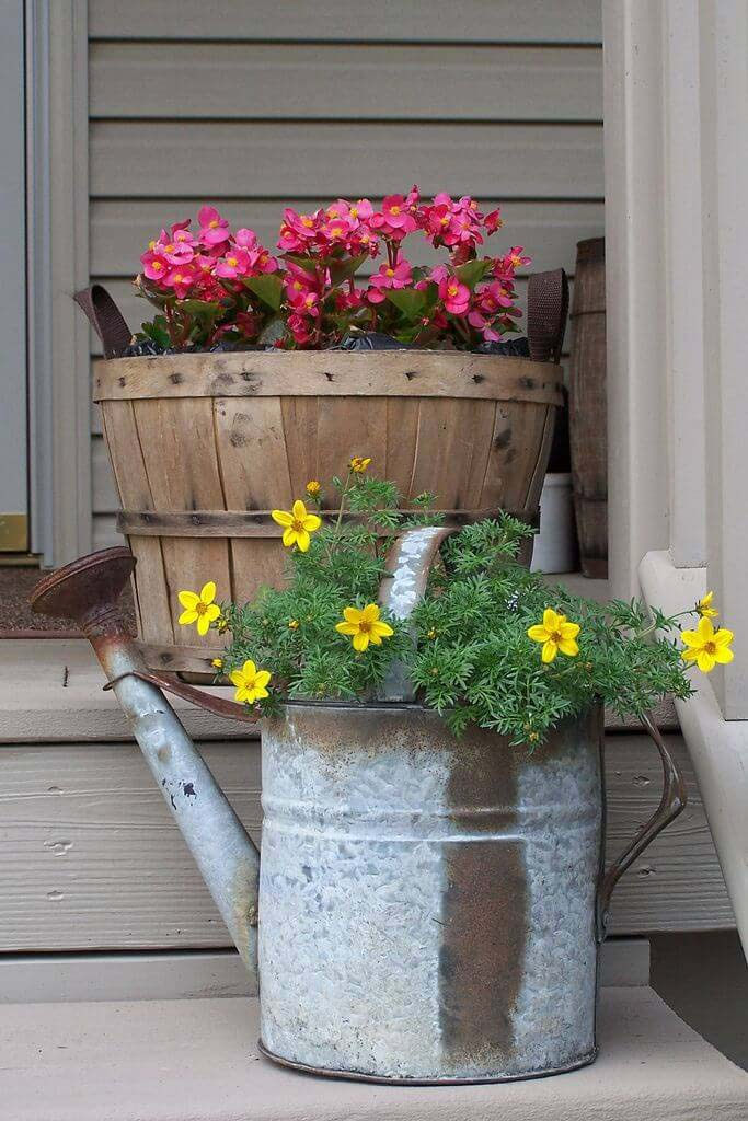 Flowers in a Barrel and Watering Cans #diy #planter #porch #decorhomeideas