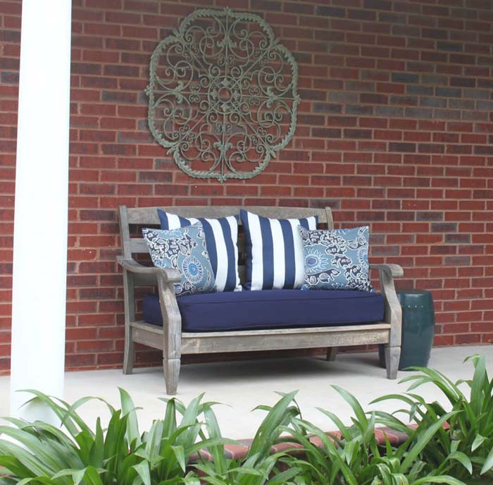 Metal Scrollwork Wall Hanging Over a Bench #porch #wall #decor #decorhomeideas