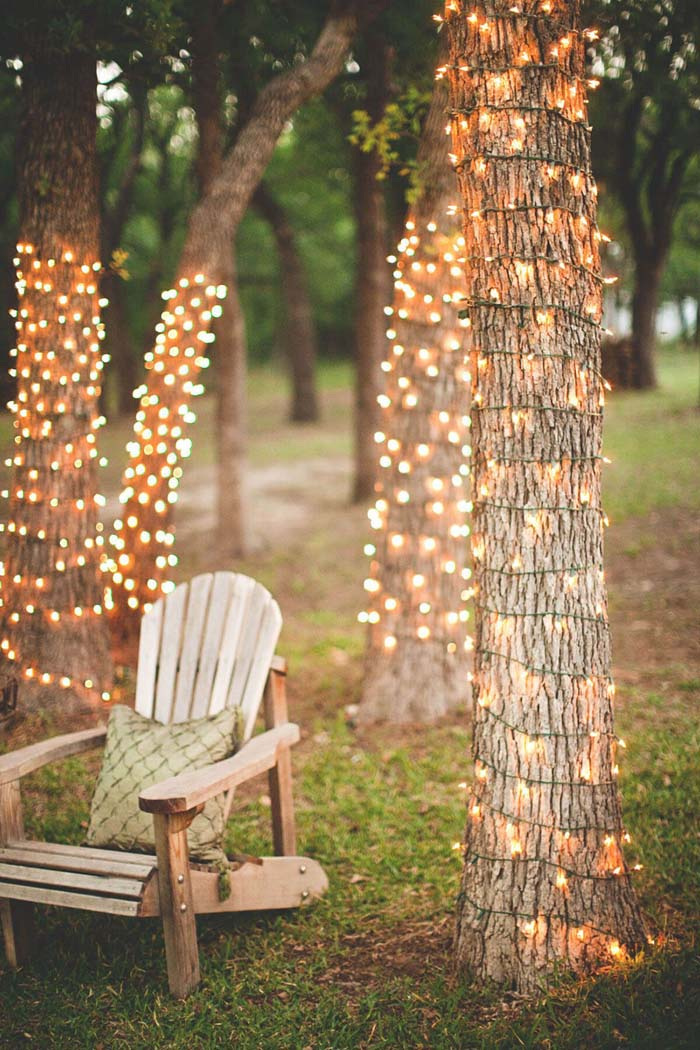 Tree Trunks Wrapped with Lights #lighting #landscape #garden #decorhomeideas