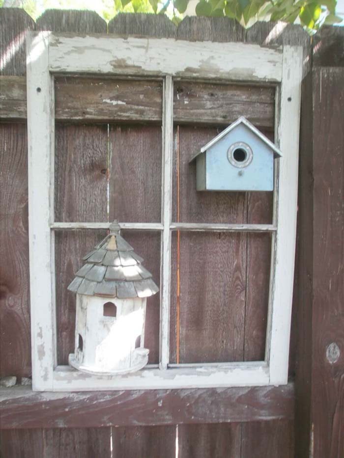 Frame a Cute Birdhouse on the Fence #old #window #garden #decorhomeideas