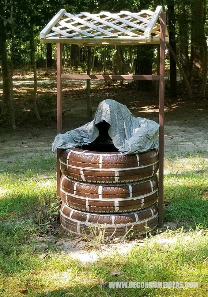 Garden Ghost Climbing Out of Well Made of Old Tires