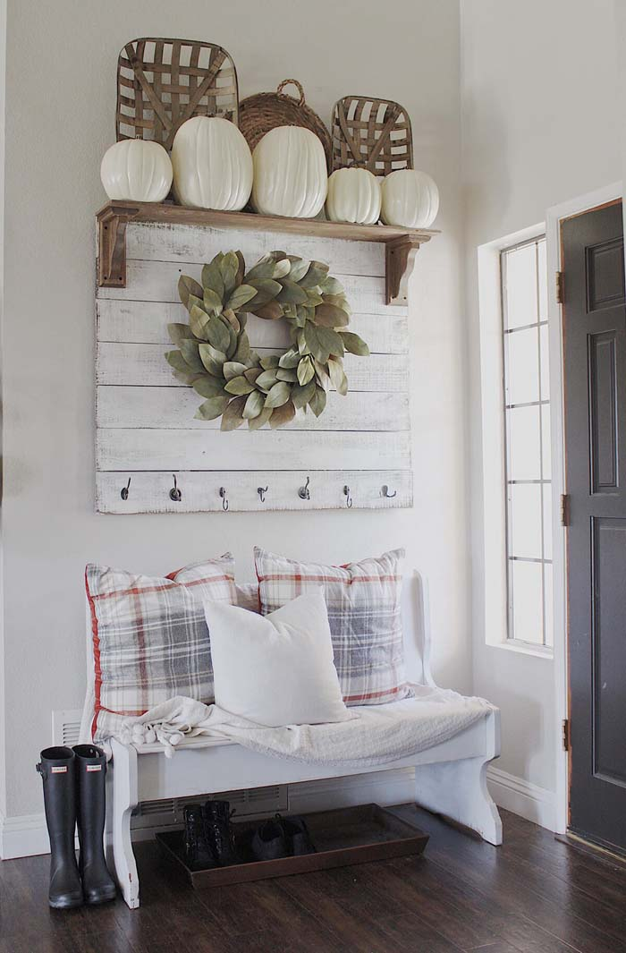 Mounted Wreath and Plaid Pillows in Pastels #small #entryway #decor #decorhomeideas