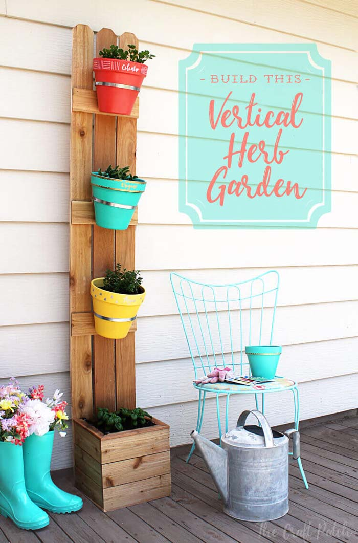 Vertical Planter with Fence Slats and Terra Cotta Pots #flowerpot #clay #garden #decorhomeideas