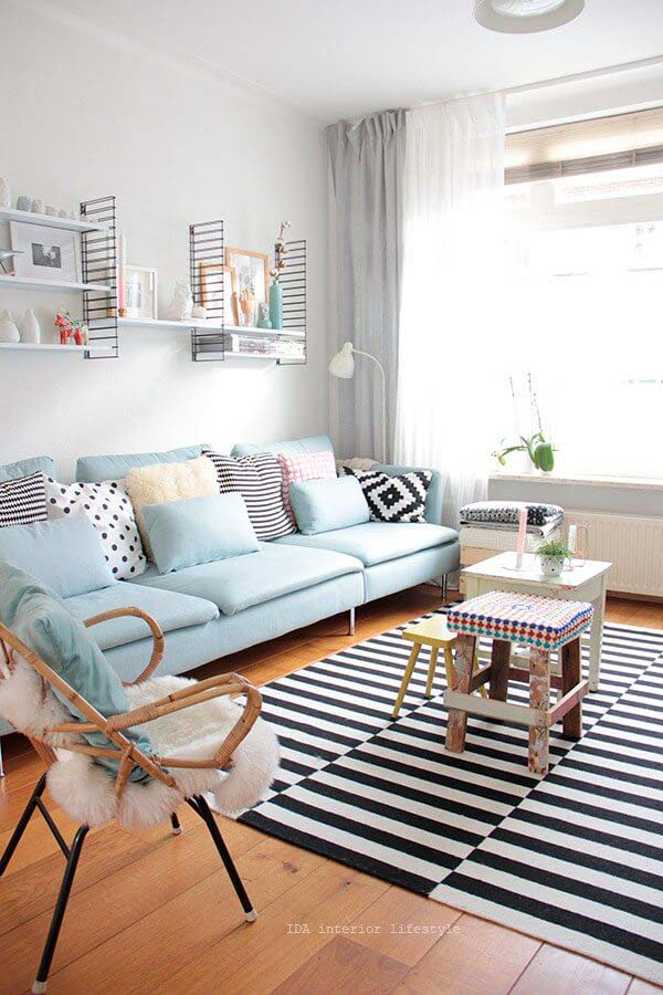 Sky Blue Sofa with Bold Striped Rug #livingroom #design #decorhomeideas