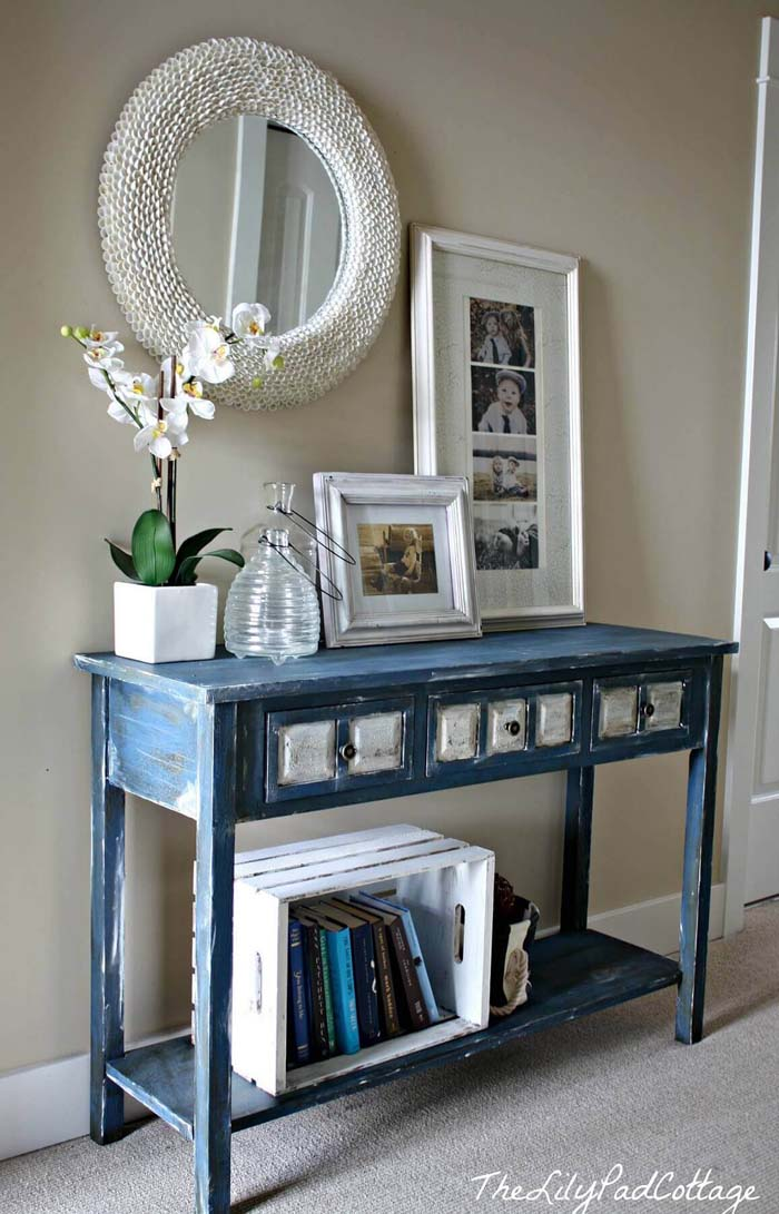 White Decor Accents On Distressed Blue Entry