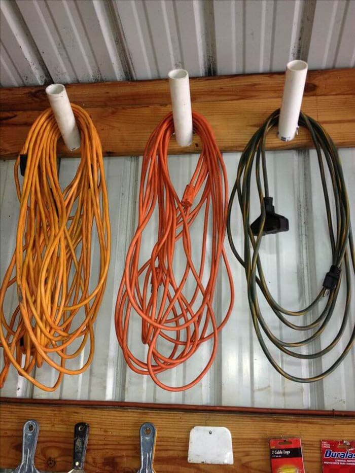 Easy PVC Pipe Cord Collectors #garage #organization #declutter #decorhomeideas
