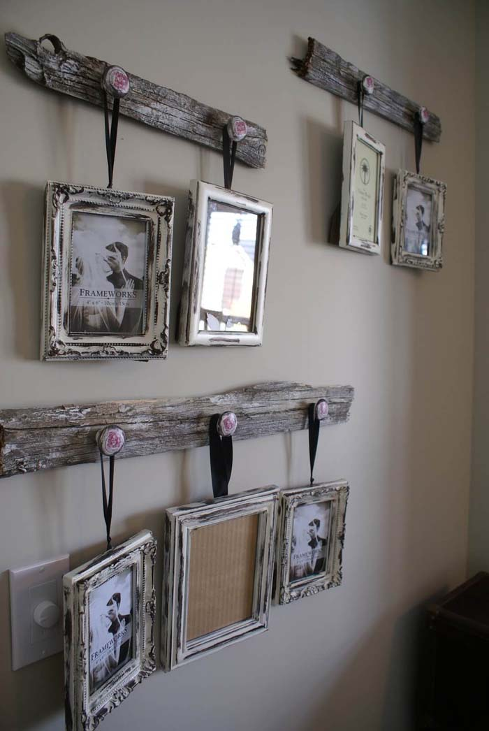 Distressed Frames Hanging from Reclaimed Wood #rustic #livingroom #walldecor #decorhomeideas