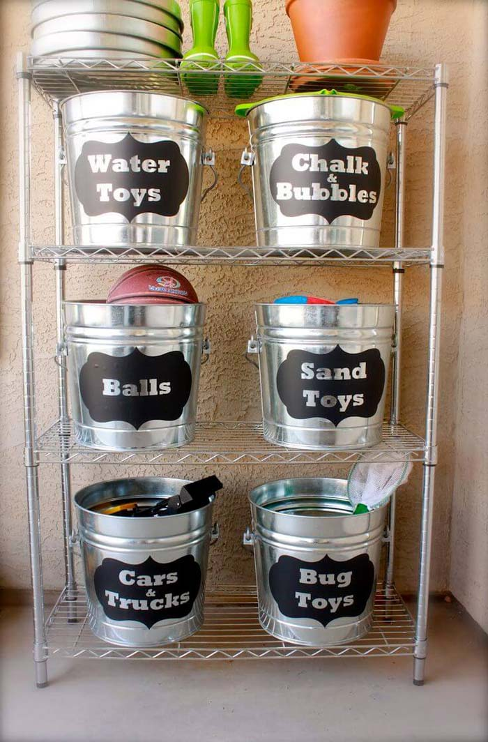 Fun Kids' Labeled Bucket Stash Rack #garage #organization #declutter #decorhomeideas