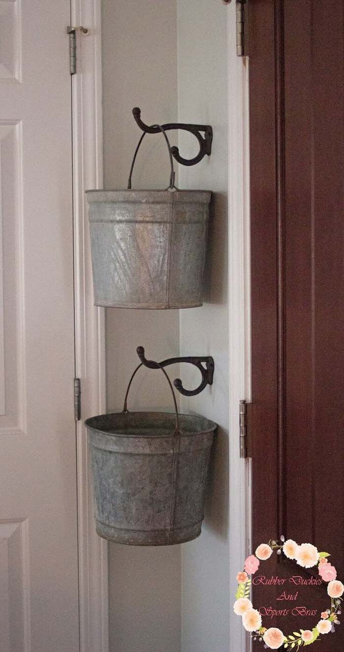 Organize Odds and Ends with Old Buckets #galvanized #tub #bucket #decorhomeideas