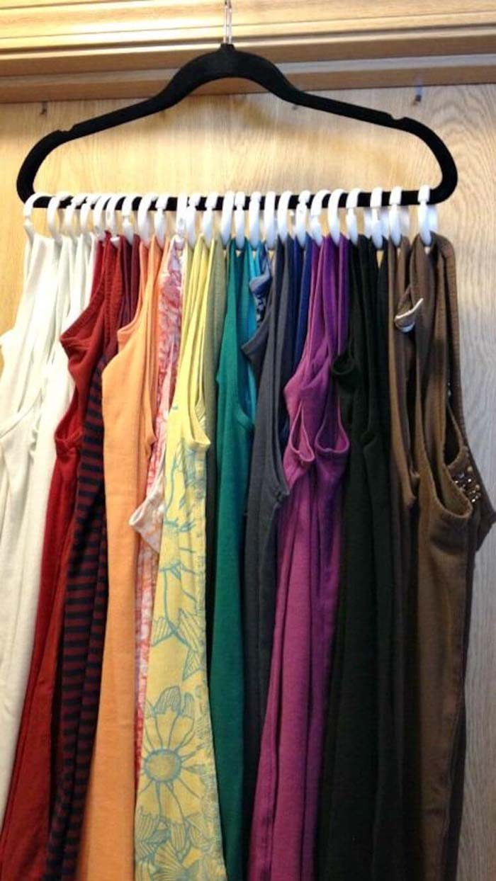 A Rainbow of Tanks on One Hanger #dollarstore #storage #organization #decorhomeideas