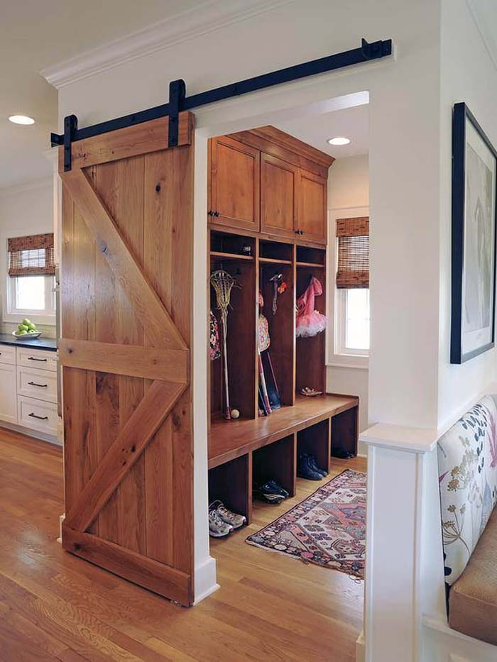 Wooden Barn Door And Rustic Feel #storage #mudroom #organization #decorhomeideas