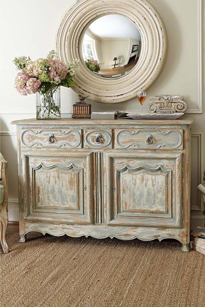 Antiqued Credenza and Rustic Round Mirror #frenchcountry #decor #decorhomeideas