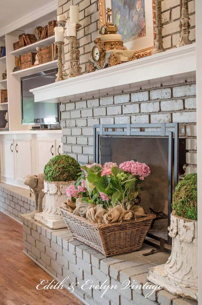 Grey Brick Fireplace with Potted Spring Flowers #frenchcountry #decor #decorhomeideas