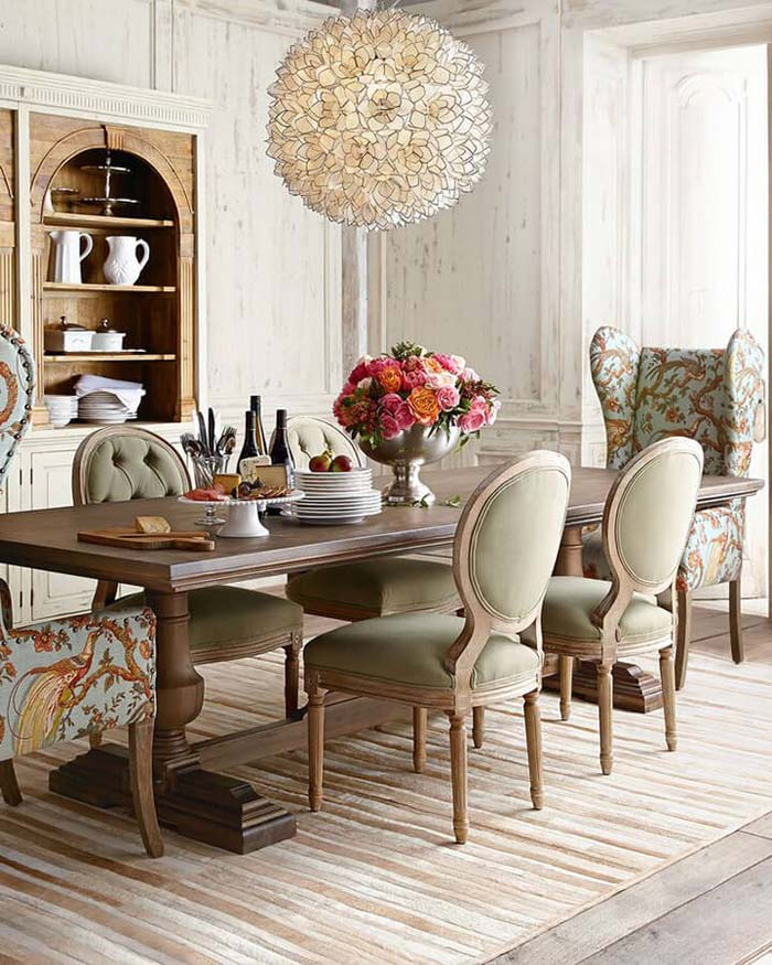 High-Ceilinged Dining Room with Fanciful Chairs #frenchcountry #decor #decorhomeideas