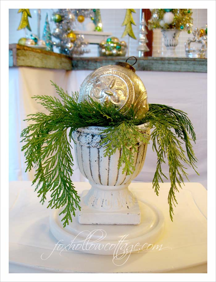 Oversized Christmas Ball in a Nest of Greenery #Christmas #urns #decorations #decorhomeideas