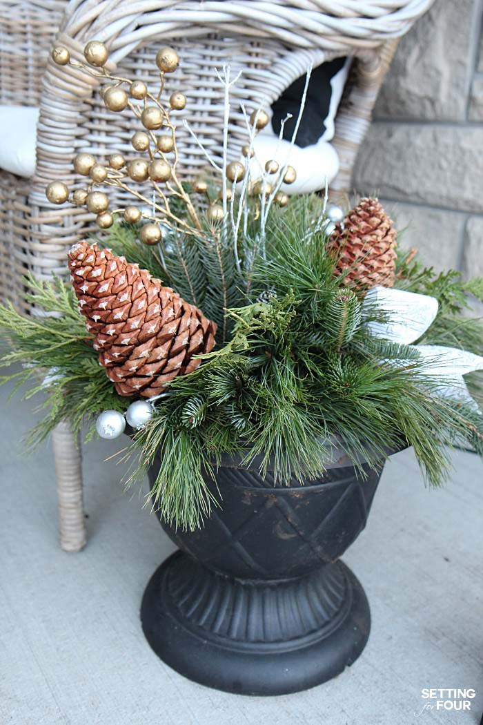 Pine Cones and Golden Berries in a Vintage Planter #Christmas #urns #decorations #decorhomeideas