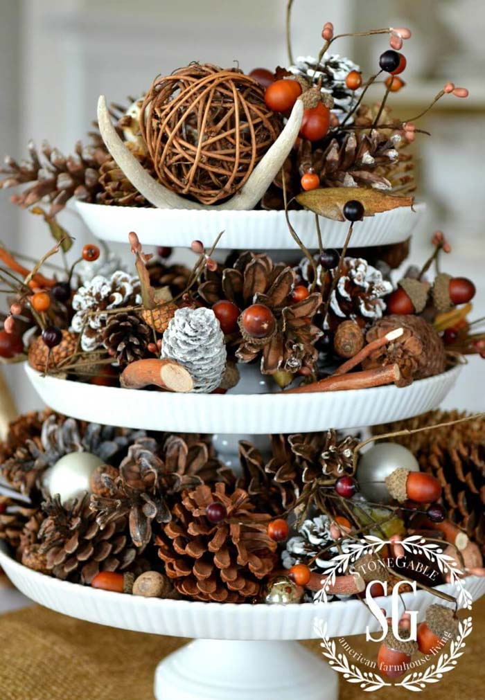 Rustic Tiered Display With Backyard Finds And Frosted Pinecones #Christmas #cakestand #decorhomeideas