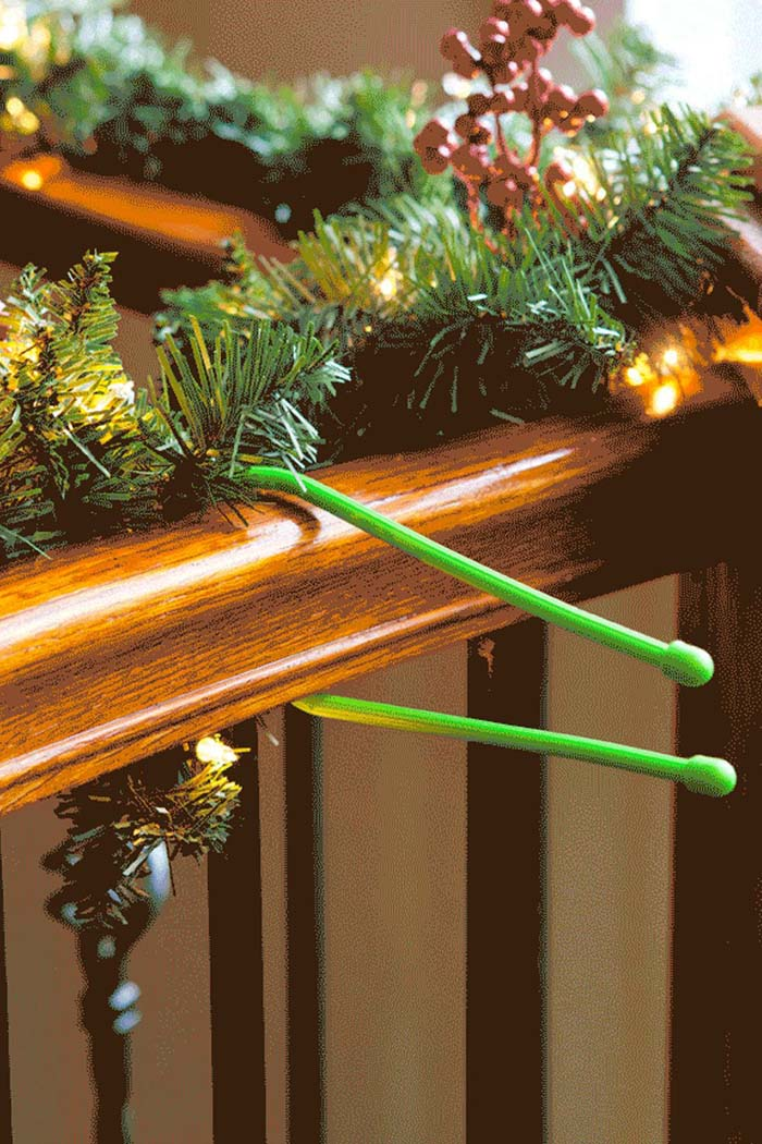 Use Cable Organizers to Attach Garland #Christmas #hanginghacks #decorhomeideas