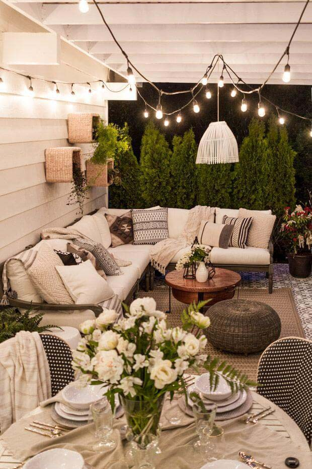 Clean White Walls, Fabric, and Bulbs Lighten this Outdoor Space #lighting #yard #outdoor #decorhomeideas