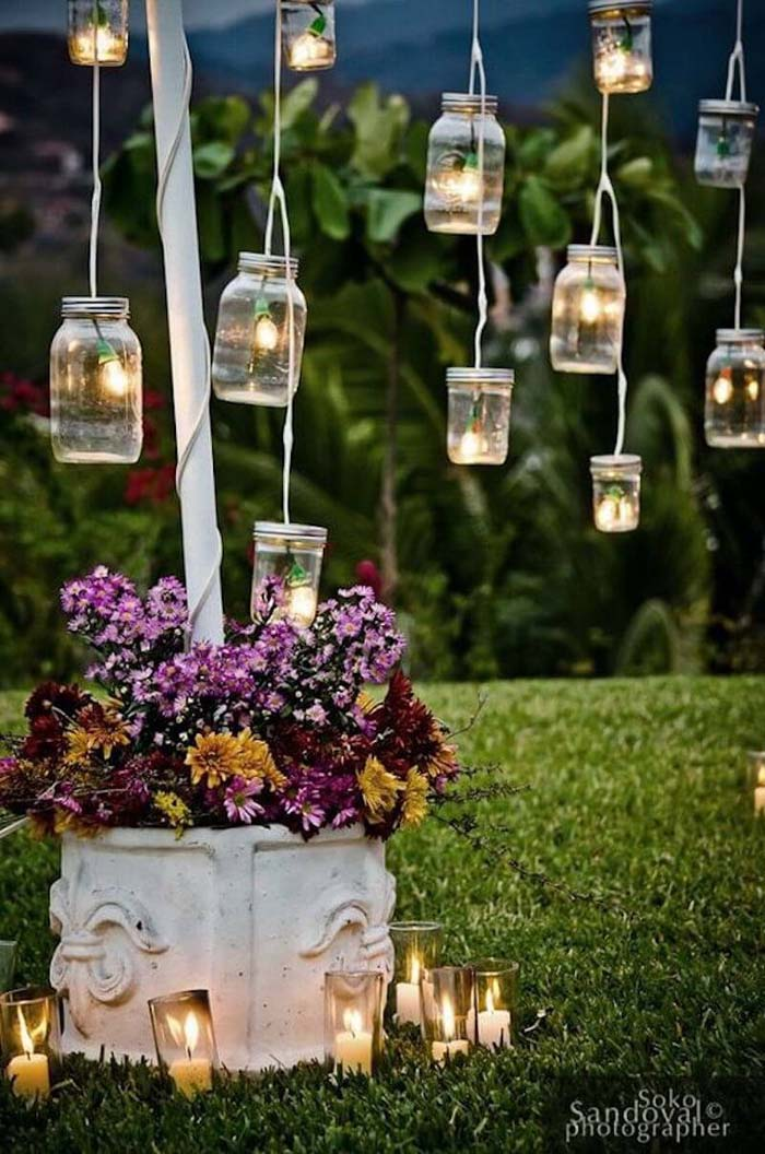 Fairy Lights Join with Mason Jars in this Simple and Pretty Solution #lighting #yard #outdoor #decorhomeideas
