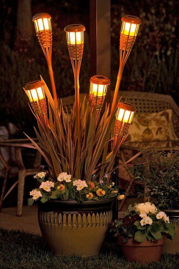 Level up your Tiki-torch Game with Creative Placement #lighting #yard #outdoor #decorhomeideas