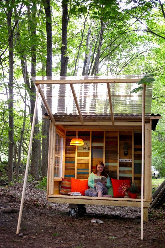 Tiny Rolling Cabin Made with Reclaimed Materials #backyardhouse #decorhomeideas