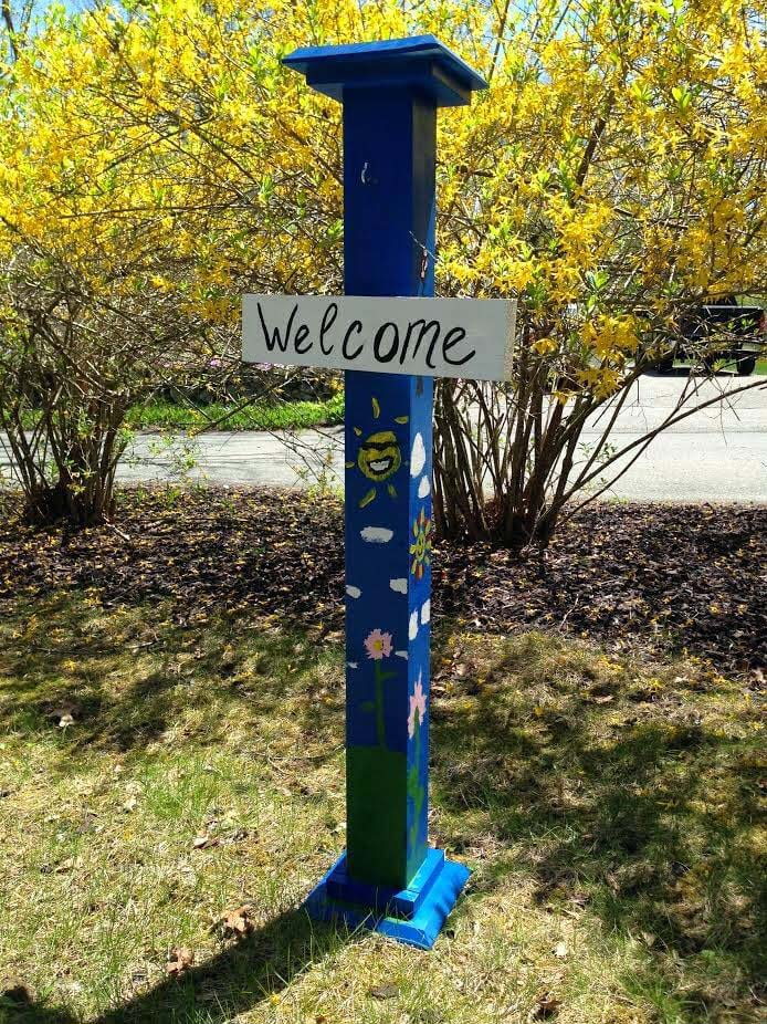 Whimsical Painted Garden-Themed Post and Simple Sign #porch #post #decorhomeideas