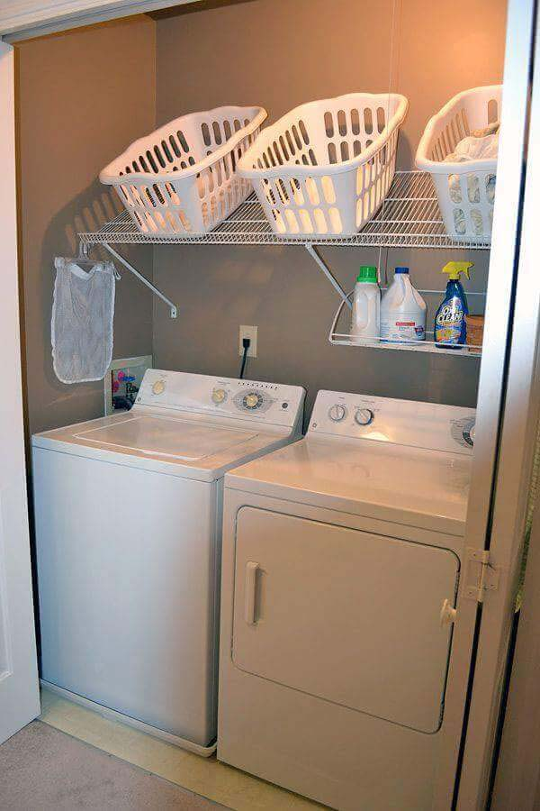 Angled Shelving Conveniently Holds Laundry Baskets #storage #organization #decorhomeideas