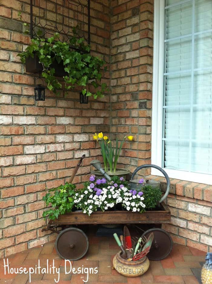 Antique Wagon, Watering Can and Potted Flowers #rustic #springdecor #porch #decorhomeideas