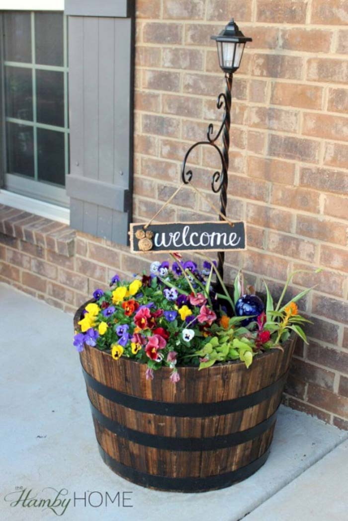 "Flower Barrel, Lamp Post and ""Welcome"" Sign #rustic #springdecor #porch #decorhomeideas"