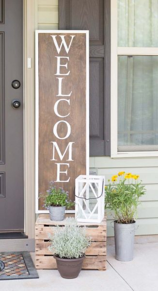 "Wooden ""Welcome"" Sign and Metal Potted Plants #rustic #springdecor #porch #decorhomeideas"