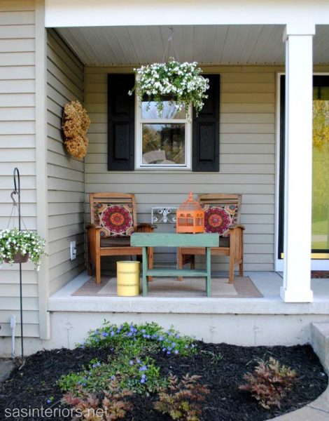 Wooden Chairs and Table With Colorful Pillows #rustic #springdecor #porch #decorhomeideas