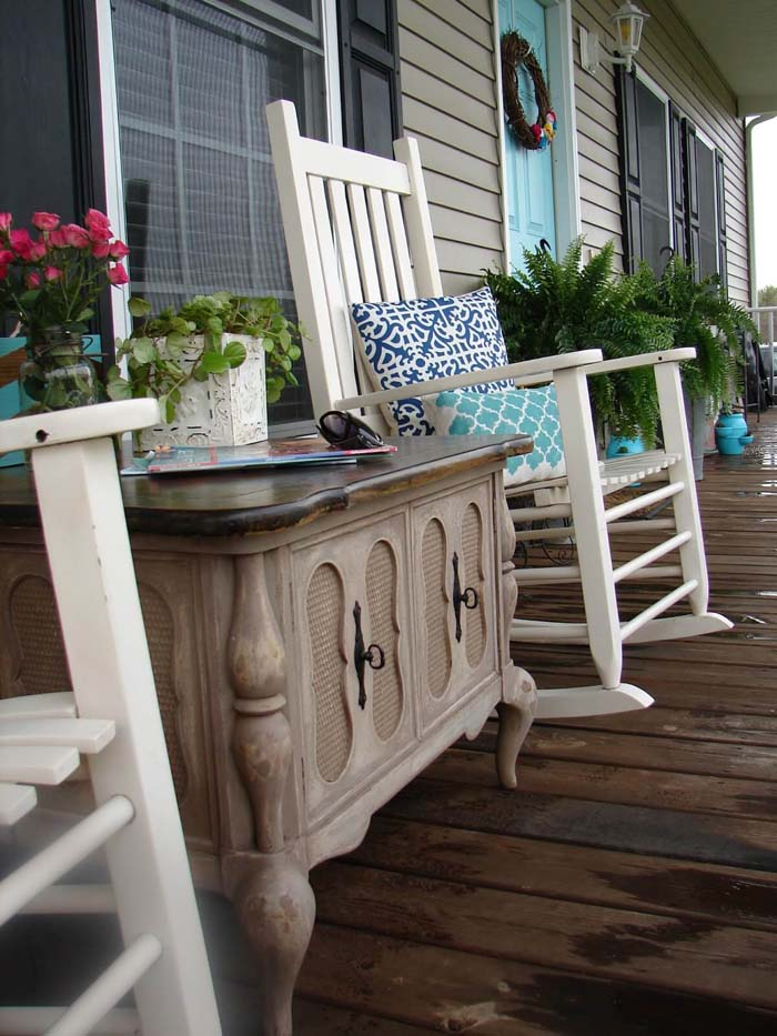 Wooden Table, Rocking Chairs, and Patterned Pillows #rustic #springdecor #porch #decorhomeideas