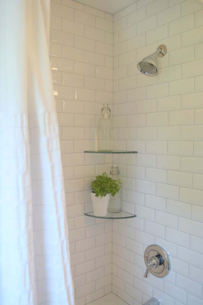 Clear Glass Shelves Float In A White Shower