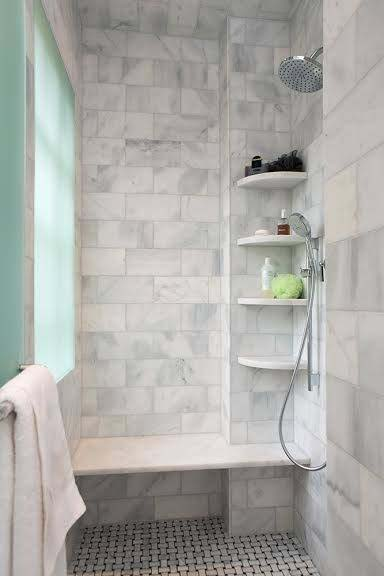 Grey And White Tiled Shower With Corner Shelves
