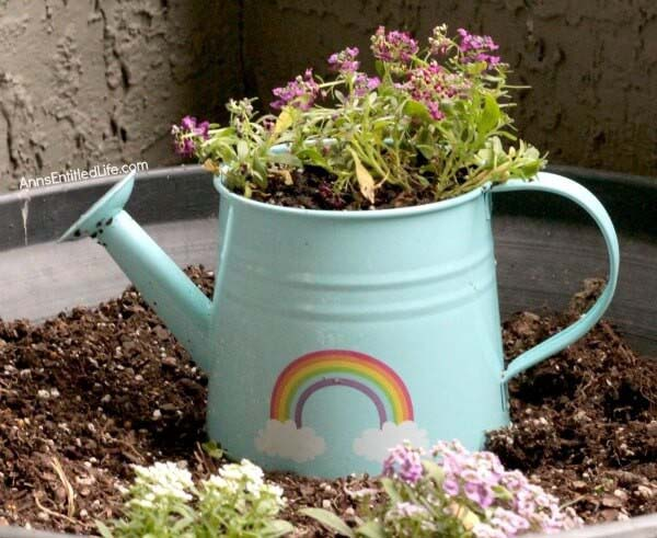 Turquoise Watering Can Flower Container #gardencontainer #garden #planter #decorhomeideas