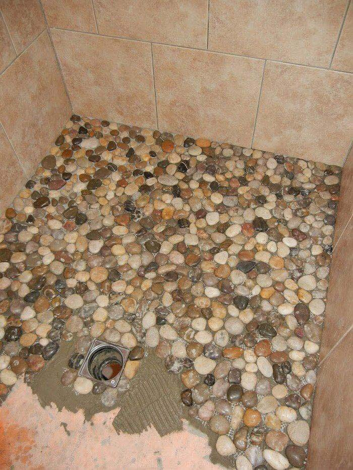 Bring the Outdoors Indoors With This Stone Shower Tiling #homedecor #pebbles #rocks #decorhomeideas