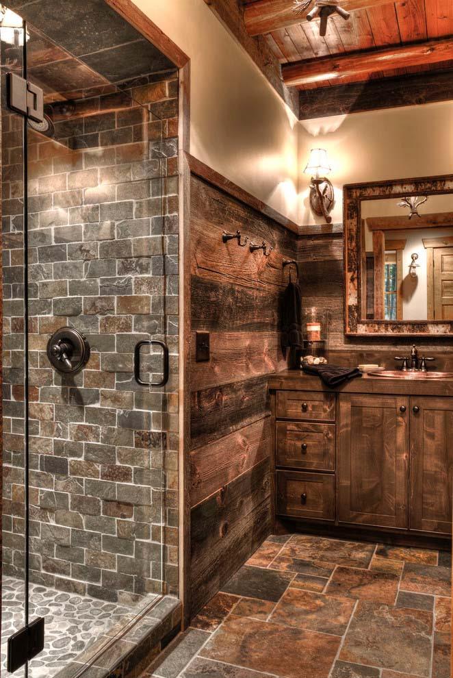 Stone Lodge Bathroom Featuring a Camo-edged Mirror #rusticbathroom #rusticdecor #decorhomeideas