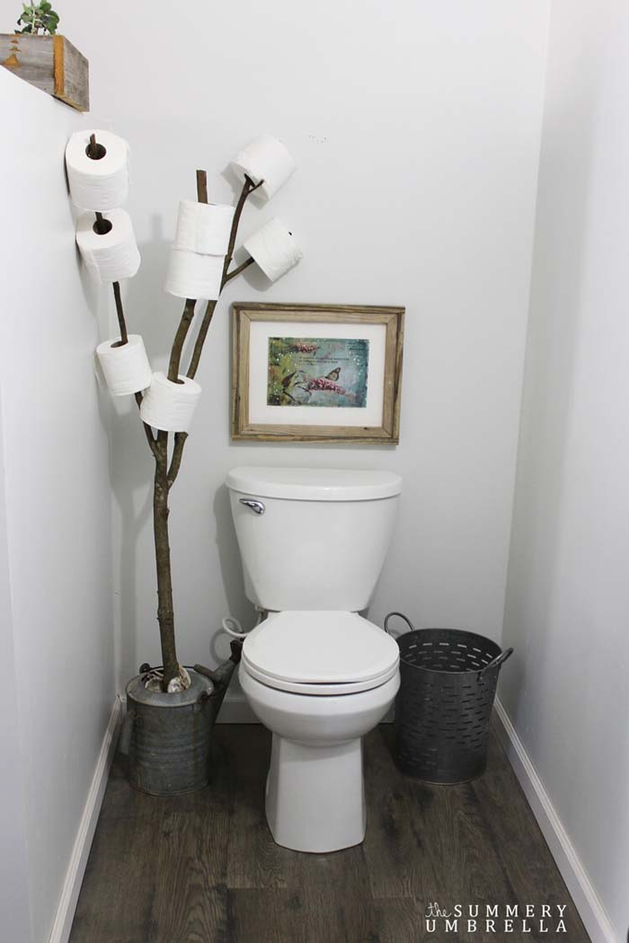 Toilet Paper Tree and Watering Can Decoration #rusticbathroom #rusticdecor #decorhomeideas