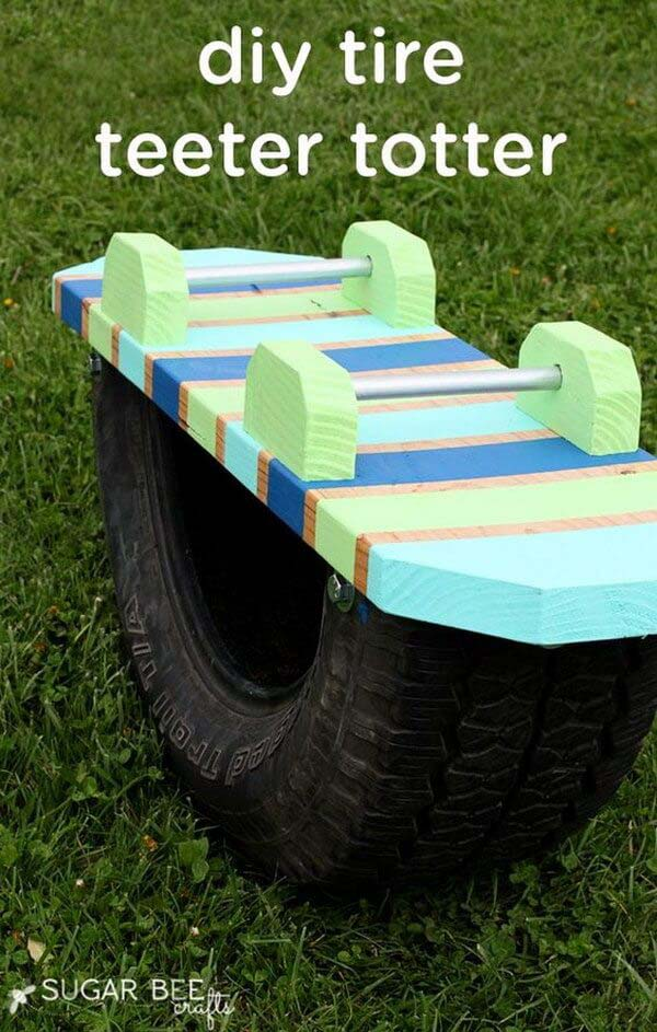 A Colorful Teeter Totter for Little Ones #backyardkidsgames #diybackyardgames #decorhomeideas
