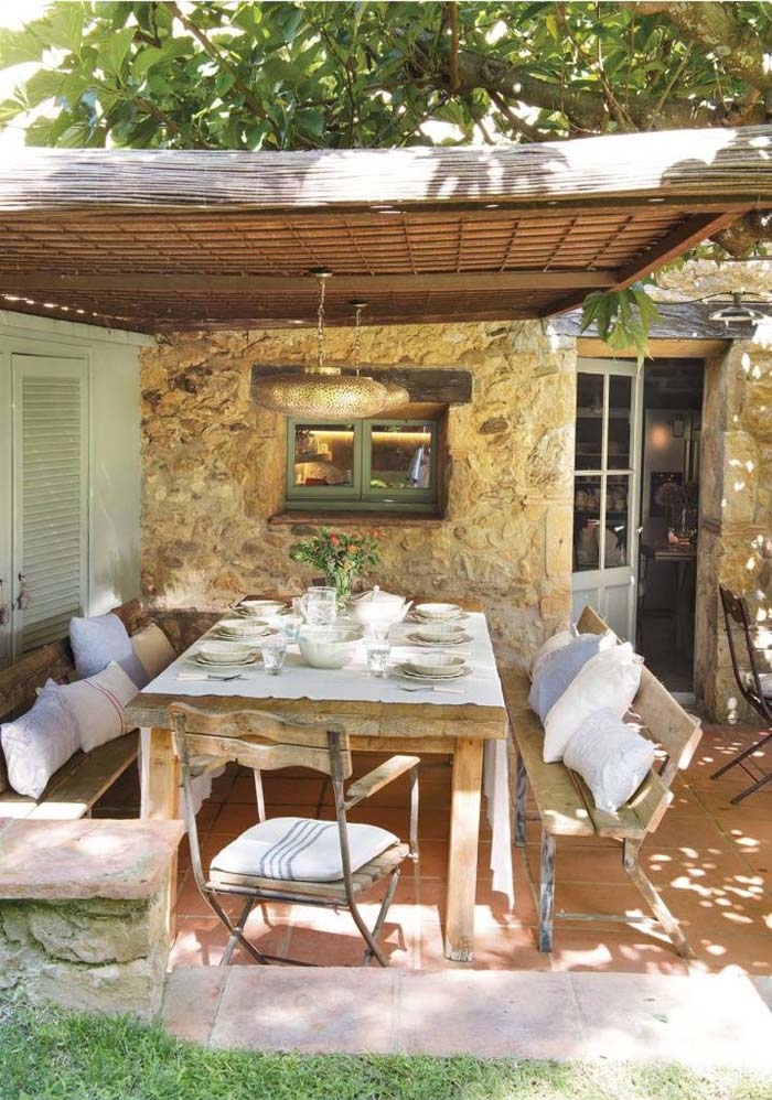 Reclaimed Wood Seating and Natural Stone #rusticpatioideas #rusticpatio #decorhomeideas