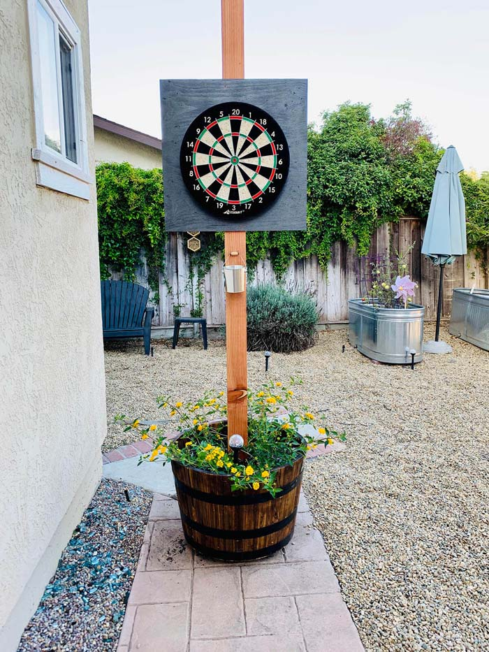 Rolling Potted Plant Dartboard Stand #diybackyardgames #outdoorgames #decorhomeideas
