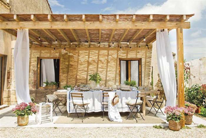 Rustic Covered Patio with White Curtains #rusticpatioideas #rusticpatio #decorhomeideas