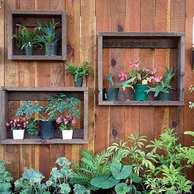 Upcycled Crate Shelves for Container Gardening #fenceplanters #fenceflowerpots #decorhomeideas